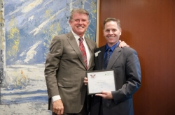 """Todd is recognized, October 2014, by Idaho Governor, CL """"Butch"""" Otter, for his volunteer work in elementary and high school classrooms for Junior Achievement of Idaho."""